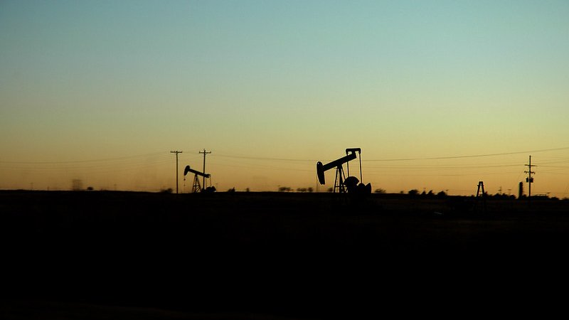 Oil wells at dusk